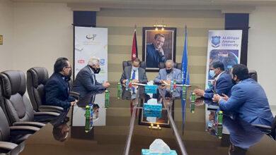 صورة مذكرة تفاهم بين جامعة عمان الأهلية ومركز العالم العربي للتنمية الديمقراطية وحقوق الإنسان